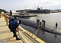 US Navy 070926-N-2638R-005 Line handlers take in mooring lines as Los Angeles-class attack submarine USS Jefferson City (SSN 759) moors at Fleet Activities Yokosuka for a scheduled port visit.jpg