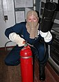 US Navy 071126-N-9793B-001 Master-at-Arms 2nd Class Dana Loney uses a CO2 bottle to attack a mock electrical fire aboard USS Constitution.jpg