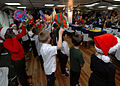 US Navy 071210-N-4399G-169 Students from Ikego Elementary School's Spanish-immersion first and second grade classes visit the amphibious command ship USS Blue Ridge (LCC 19) and 7th Fleet Sailors to sing Spanish-influenced Chri.jpg