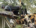 US Navy 080903-N-6266K-122 Leonard Cato nd friend Steve Marshall work to clear Cato's niece's home of a fallen tree.jpg