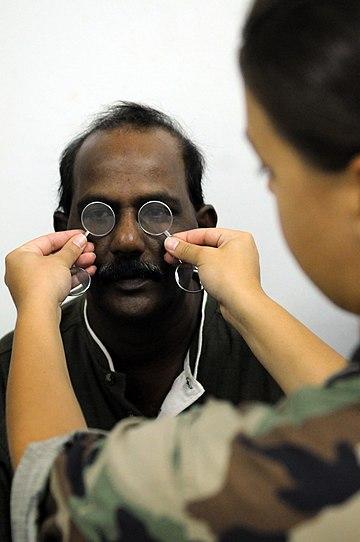 US Navy 081027-N-5642P-127 Lt. Megan Rieman gives a Trinidadian man a general eye exam.jpg