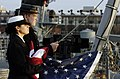 US Navy 081206-N-5758H-025 Chief Quartermaster Stephanie Kotatis Boatswain's Mate Seaman Dustin Foster raise the Colors aboard Freedom.jpg