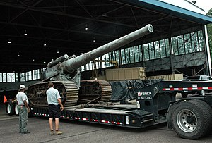 "7""/44 caliber gun - Transportation personnel at Naval Support Facility Dahlgren prepare to off-load a World War I-era 7-inch gun on a tracked mount, the first gun originally test-fired to mark the establishment of Dahlgren as a naval proving ground on Oct. 16, 1918. The 7-inch, 45 caliber gun will be restored by the Naval Surface Warfare Center Dahlgren Division."