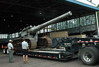 """7""""/44 caliber gun - Transportation personnel at Naval Support Facility Dahlgren prepare to off-load a World War I-era 7-inch gun on a tracked mount, the first gun originally test-fired to mark the establishment of Dahlgren as a naval proving ground on Oct. 16, 1918. The 7-inch, 45 caliber gun will be restored by the Naval Surface Warfare Center Dahlgren Division."""