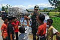 US Navy 091010-N-9123L-026 Commander, Amphibious Force Seventh Fleet, Rear Adm. Richard Landolt meets with some children outside the Humanitarian Assistance Rapid Response Team medical tent in Padang, Indonesia.jpg