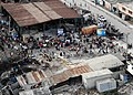 US Navy 100116-N-6247V-137 Haitian citizens gather in a dilapidated marketplace in Port-au-Prince, Haiti, Jan. 16.jpg