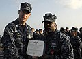 US Navy 100217-N-7638K-141 Cmdr. Nate Moyer and Operations Specialist 1st Class Anthony Ford, from Baltimore, Md., pose for a photo after Ford was awarded a Bronze Star Medal.jpg