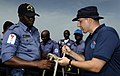 US Navy 100315-N-7948C-116 Coast Guard Chief Warrant Officer 3 Earl Schlemmer shows Nigerian navy Petty Officer Ademola Obalaja proper knot-tying techniques during a basic small boat operation workshop.jpg
