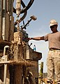 US Navy 100427-N-8816D-101 Equipment Operator 1st Class Jose Martinez, assigned to the water well detachment of Naval Mobile Construction Battalion (NMCB) 133.jpg