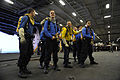 US Navy 110718-N-YC446-799 Sailors aboard the aircraft carrier USS Dwight D. Eisenhower (CVN 69) participate in firefighting training during a gene.jpg