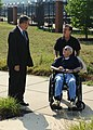 US Navy 110808-N-WE887-018 John Love, a World War II veteran, along with his son Tim Love, are escorted by Jay Deloach during a tour of the conning.jpg