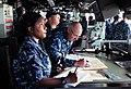 US Navy 111123-N-FH966-044 Quartermaster 2nd Class Latoya Earls and Quartermaster 1st Class Jonathon Voldberg plot a course for the amphibious assa.jpg
