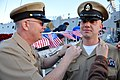 US Navy 111214-N-AW702-006 A Sailor is pinned as chief by his father.jpg