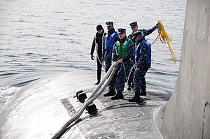 US Navy 111221-N-DI599-034 Sailors aboard the Virginia-class submarine USS North Carolina (SSN 777) arrive at Fleet Activities Yokosuka.jpg