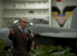 US Navy 111227-N-DR144-836 Ambassador Stephen Young delivers remarks during a reception for Hong Kong guests in the hangar bay aboard the Nimitz-cl.jpg
