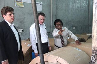 United States Senate Committee on Foreign Relations - Chris Murphy and another official from the US Senate Foreign Relations Committee inspecting burnt down printing press of Uthayan newspaper in Jaffna on December 7, 2013 while E. Saravanapavan, the Managing Director of the newspaper explaining something to him.
