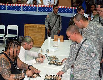 Umaga (wrestler) - Fatu and Jeff Hardy signing autographs to U.S. soldiers