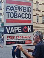 "E-cigarette retailer marketing sign in Williamsburg, Brooklyn, New York, Unites States. The sign states, ""F#@K Big Tobacco, vape on, and free tastings""."