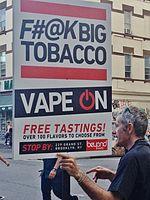 E-cigarette retailer marketing sign in Williamsburg, Brooklyn, New York, Unites States. The sign states,