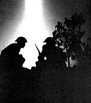Battle of Verrières Ridge - Canadian soldiers under fire near Fleury-sur-Orne in the early hours of 25 July 1944