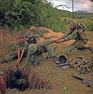 "Tunnel rat - Operation ""Oregon,"" a search and destroy mission conducted by an infantry platoon of Troop B, 1st Reconnaissance Squadron, 9th Cavalry, 1st Cavalry Division (Airmobile), three kilometers west of Duc Pho, Quang Ngai Province. An infantryman is lowered into a tunnel by members of the reconnaissance platoon. Photograph taken 24 April 1967"