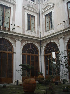 Villa del Poggio Imperiale - A corner of the main courtyard.  The 18th century Baroque segmented pediments above the windows survived the 19th century rebuilding.