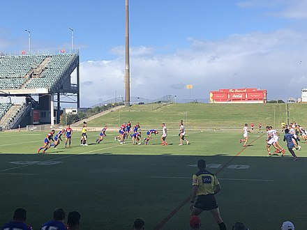 A rugby league match being played at Wollongong Showground, one of two home grounds used by the St. George Illawarra Dragons. WIN Stadium trial match.jpg