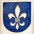 Warburger Wappen mit Lilie an einer Hauswand.jpg