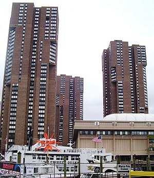 Waterside Plaza - Three of the four towers of Waterside Plaza seen from the south, with the United Nations International School in the right foreground