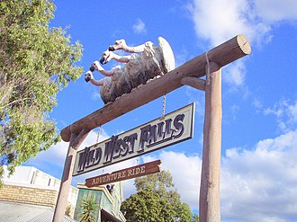 Wild West Falls Adventure Ride - The long path towards Wild West Falls is marked by an entrance sign.