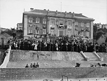 A black and white photo of a crowd gathered outside the William Booth Memorial Training College building.