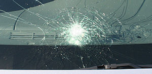 "Laminated glass - Automobile windshield with ""spider web"" cracking typical of laminated safety glass."