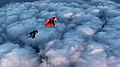 Wingsuits Over Heavy Clouds (6367633489).jpg