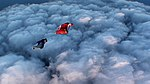 Wingsuits Over Heavy Clouds (6367633489).jpg
