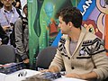 WonderCon 2012 - Joshua Jackson of Fringe signs the Fringe comic he wrote (6873502190).jpg