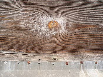 English: Wooden plank with nailed aluminum she...