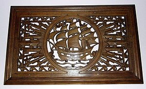 """Archibald Dawson - Wooden carving in Port Glasgow town hall. An adjacent plaque reads """"These carvings were designed and crafted in 1936 by the head of Glasgow School of Sculpture, Archibald Dawson, as part of a church improvement scheme which was funded by the members of Newark Parish Church and Sir James Lithgow."""""""