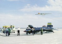 X-15 on Lakebed with B-52 Mothership Flyover - GPN-2000-000400.jpg