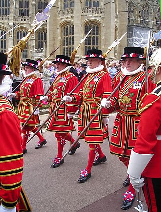 Livery - Yeoman of the Guard wearing tunics in the Royal Livery colours of scarlet and black processing to St George's Chapel, Windsor for the annual service of the Order of the Garter in 2006.