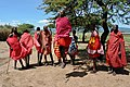 Young Masai men do their iconic jumping dance for tourists.jpg
