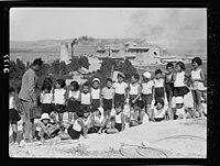 Zionist activities around Haifa. Haifa, school children on Carmel slope in background the Nesher (Cement Works) LOC matpc.15208.jpg