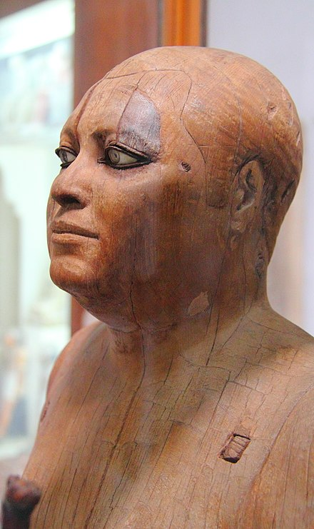 Wooden statue of the scribe Kaaper, 5th or 4th dynasty of the Old Kingdom, from Saqqara, c. 2500 BC Agyptisches Museum Kairo 2016-03-29 Ka-aper 01.jpg