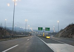 An exit leading to the A6 motorway, as seen from the A1.