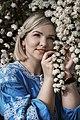 День Вишиванки. Молода україночка у вишитій синій сукні серед квітів 02.jpg