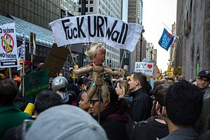 "Timeline of protests against Donald Trump - Protests in New York City on April 14, 2016. One banner reads ""Fuck UR Wall"", denouncing Trump's policy on immigration."