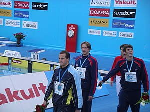 Michael Phelps - Victory lap of the 100 m butterfly during the 2005 FINA World Championships in Montréal. Phelps is far right.