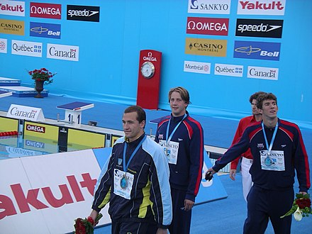 Victory lap of the 100 m butterfly during the 2005 FINA World Championships in Montreal. Phelps is far right. 2005 FINA World Championships - victory lap of the 100 m butterfly.jpg