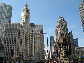 Magnificent Mile - The view north from the foot of the Magnificent Mile in the Michigan–Wacker Historic District: the Beaux Arts Wrigley Building (left) and neo-Gothic Tribune Tower