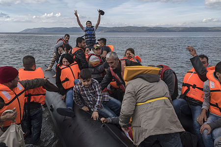 A boat with Syrian refugees arrives safely to Lesvos island, Greece.