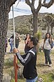 2017 Student Summit on Climate Change - Joshua tree Monitoring Project - Students measure the height of a Joshua tree (33338110102).jpg